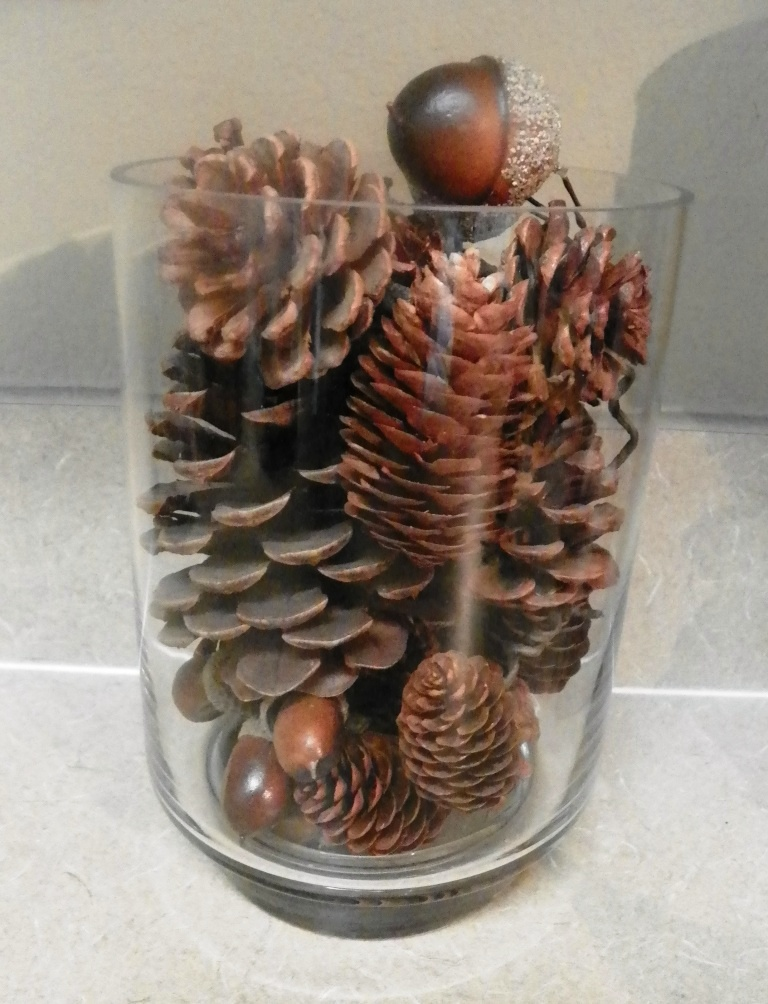 glass container of pine cones 01