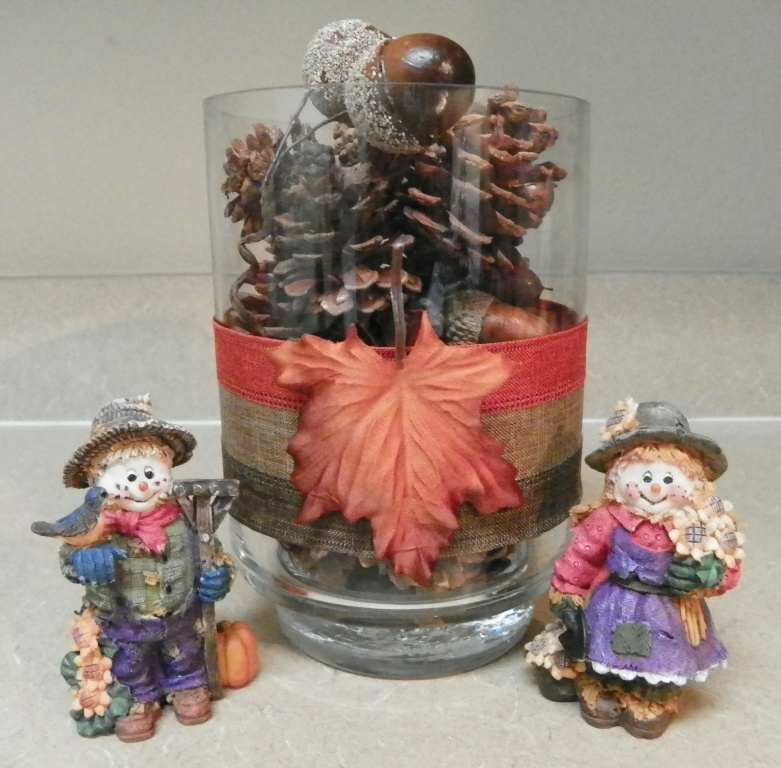 pine cone container beside fall figurines