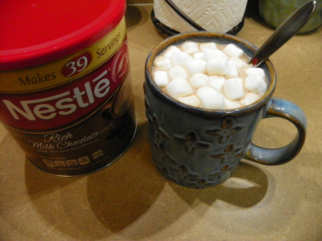 cocoa canister and hot cocoa mug