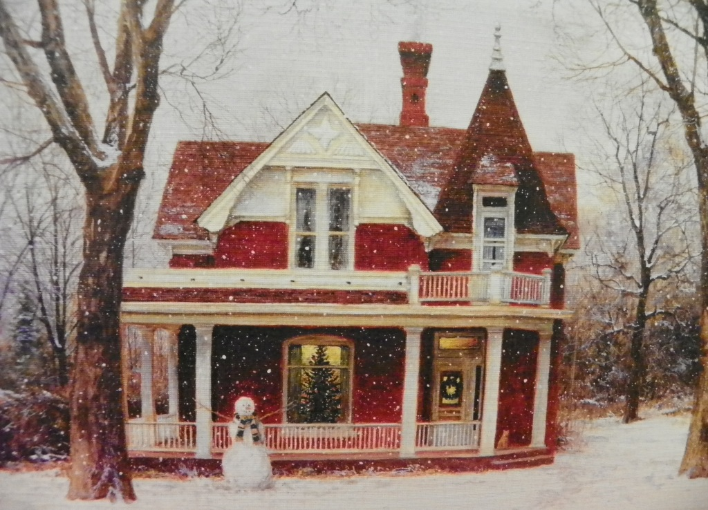 red house and snowman and cat on porch
